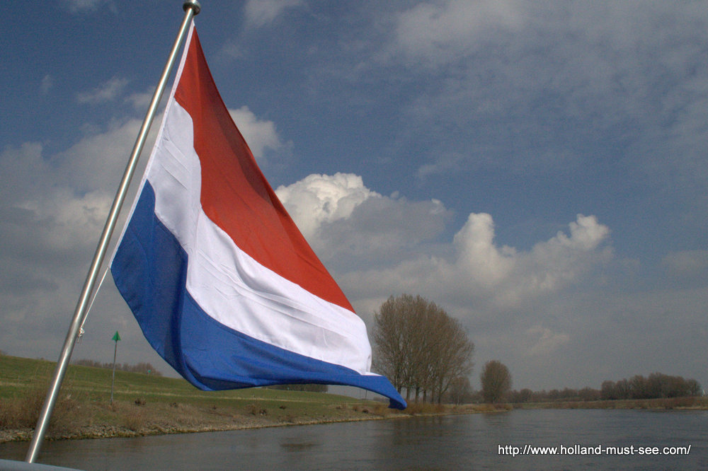 Dutch flag flying over the river IJssel